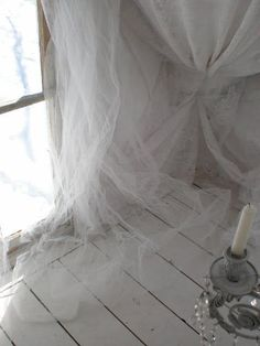 winter white tulle at window