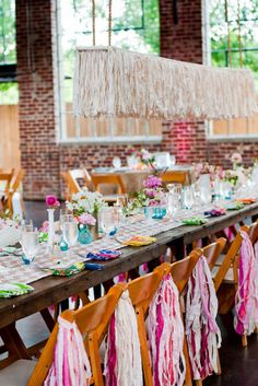 Love tassels? Suspend over reception table and/or hang from backs of chairs. Source: Lauren Nicole Studios #tassels #chairdecor tassel