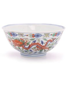 Fine quality Chinese porcelain Doucai bowl. Decorated with two dragons, one green and one orange. The underside bearing a six character Kangxi mark. Originally