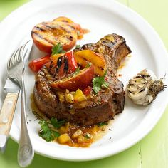 These Peach-Glazed Pork Chops get a fiery bite from Thai hot sauce. Recipe: http://www.bhg.com/recipe/pork/peach-glazed-chops/?socsrc=bhgpin060612