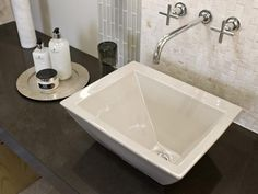 Sculptural in form, a vessel sink fashioned from vitreous china pops against the dark quartz.  #HGTVUrbanOasis  http://www.hgtv.com/urban-oasis/hgtv-urban-oasis-2013-master-bathroom-pictures/pictures/page-2.html?soc=pinterest