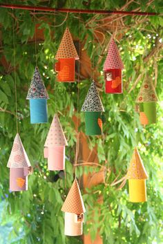 Crescent and Old Lace: Toilet paper cardboard rolls & wrapping paper mobile. Could make them Halloween looking as Bat houses.