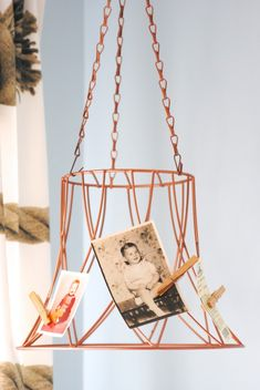 Can you guess what this USED to be? Check out 25+ thrift store makeovers, including this upcycled copper photo holder!