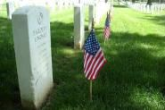 — Soldiers placed small American flags at the graves of more than 260,000 service members in...