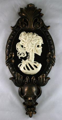 Gothic Victorian Lady Skeleton Cameo bone white in gold tone frame. $50.00, via Etsy.