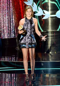 """Emma Watson photographed on stage while accepting the Best Cast award for """"Harry Potter and the Deathly Hallows: Part 2"""" onstage at the 2012 MTV Movie Awards."""