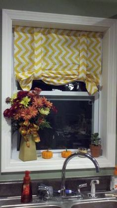 diy roman shades   singlemamalife. I need my Kitchen window to be framed just like this. Looks so much nicer with trim.