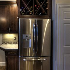 Wine Storage above refrigerator (remove cabinet doors, insert X dividers)