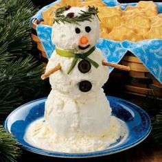 "Snowman Cheese Spread ~ This cute cheese ball snowman ""stands out"" on any appetizer buffet. He is so much fun to ""build"" and always gets a warm welcome at parties and gatherings. This is one snowman who won't melt away, but he disappears just as quickly once people get a taste of him."