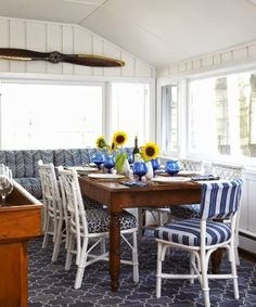 Nautical Cottage Dining Room with Boat Propeller Wall Decor. On CC: http://www.completely-coastal.com/2014/07/blue-and-white-nautical-cottage.html