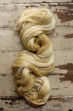 Merino Worsted Yarn: Hand-dyed with myrobalan nuts in shades of honey-gold and cream. by Camellia Fiber Company