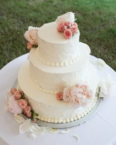 This coconut cream cake with key lime filling is adorned with fresh blooms
