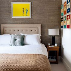 Love the texture, artwork, framed Penguin book cover prints, and neutral colours in this bedroom.
