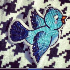 Pretty bluebird made by Ojibwe beadwork artist Summer Peters.
