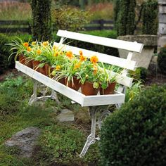 Cool idea with an old bench!!  http://homeandgarden.craftgossip.com/32-ideas-to-decorate-your-garden/