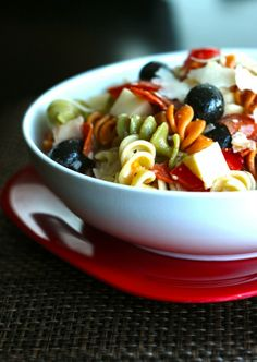 pasta salad: 1 bag colored spiral noodles  ¾ c. pepperoni cut into wedges  ¾ c. mozzarella cut into small cubes  ¾ c. fresh tomatoes, diced  ½ c. olives, sliced  ¼ c. parmesan cheese (not the powdery kind)  1 bottle Bernstein's Restaurant Recipe Italian Dressing
