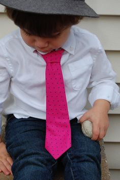 Navy blue pants, white button down shirt and pink/blue tie.  NO hat.
