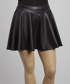 Every wardrobe needs a few beautiful basics, and this skirt fits the bill. With flirty flair, a hint of sheen and a classic shade, it's the perfect pick for a chic ensemble.