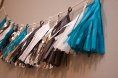 Make a DIY tassel garland for your graduation party.  All you need:  tissue paper, glue gun, scissors and string.  Save money at the craft store with coupons:  http://www.coupons.com/coupon-codes/search?query=crafts