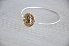 Inca Gold Coin and Sterling Silver Bracelet by GoldenPlumeJewelry, $24.00