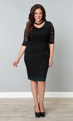 Don a one of a kind cocktail dress with our plus size RSVP Lace Cocktail Dress.  A deep hunter green lining blends with the classic black lace for a sultry combination.  www.kiyonna.com  #KiyonnaPlusYou  #MadeintheUSA  #SemiFormal
