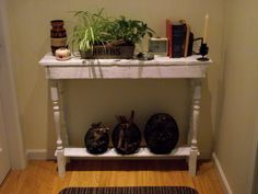 Handmade from driftwood planks and staircase spindles. Cost $4