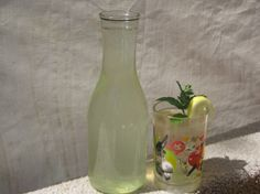 """Sassy Water """"This is from the Flat Belly Diet. It is delicious. The cucumber and lemon are natural diurectics. The ginger and spearmint help relieve bloating. Use purified water. Drink this throughout the day. Cook time is the time it is refrigerated overnight."""" Ingredients: 8 1/2 cups water 1 teaspoon grated ginger 1 medium cucumber , sliced thin 1 medium lemon , sliced thin 12 leaves spearmint Directions: 1Mix all ingredients together in a pitcher. 2Refrigerate overnight. 3Strain water. 4Drink all 8 1/2 cups during the day. 5Really good!"""