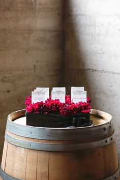 Seating chart in a tray covered with dahlias - photo by Julie Wilhite Photography, design by Stratford Events http://ruffledblog.com/roaring-romance-wedding-inspiration/ #seatingcharts