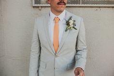 orange tie groom, photo by Caleb John Hill http://ruffledblog.com/downtown-los-angeles-wedding #wedding #grooms