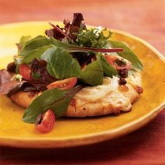 Savor the tastes of Italy by serving individual pita pizzas loaded with fresh vegetables, melted cheese, and a cider vinegar sauce. It's a one-dish meal that's sure to please.