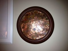 Our penny art using an old plate frame and some self-laminating sheets. Inspired by pinterest and my son's love of coins.