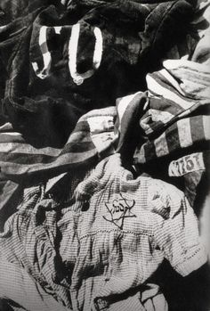 A child's dress among the clothing left at the concentration camp of Stutthof, Danzig. 1945.