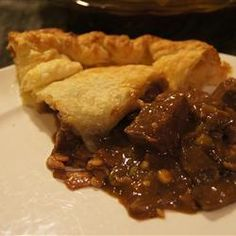 "Beef, Mushroom and Guiness Pie | ""I am in love with this pie! Itakes a while to make but it is fun and SO good! it is the perfect winter dish. super filling and warms you from head to toe! "" mushroom, guin pie, guinness, beef, english food, pies, fabul food, pie recipes, stout pie"