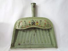I totally want a metal dustpan. I am not a fan of our ugly plastic one. Folk Art 1960's Dust Pan Green with Old Cook Stove Kitchen Scene Rustic Made in USA.