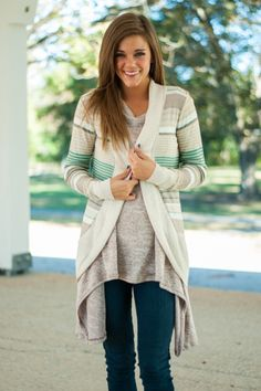 "This thin little cardigan has the most feminine and delicate feel to it! The colors are breathtaking and we love that airy fit for a warmer day! Material has fair amount of stretch. Miranda is wearing the small. Length from shoulder to hem: S/M- 30""; M/L- 31""."