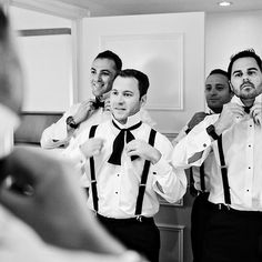 Brides.com: A Glamorous Summer Wedding in New York City. Groomsmen wore classic tuxedos by Black by Vera Wang.