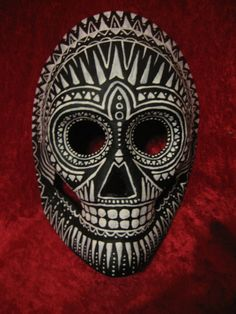 Hand painted, one of a kind, day of the dead paper mache skull mask at Lessurdorraj