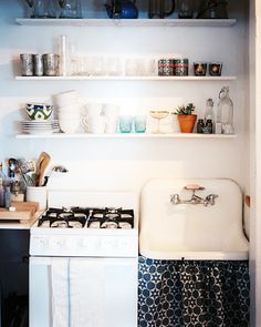 Open Shelving // Hide those unattractive cleaning supplies // Storage Solutions
