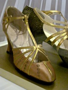 1920 shoes...In the 1920′s women's shoes focused on the strap design. Bar Shoes and T- Bar shoes were all the rage. Popular because you could dance without them slipping off !