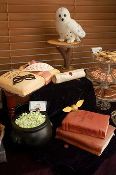 """Harry Potter birthday party - Green chocolate covered """"Troll booger"""" popcorn, """"Book"""" cake, Owl cookies."""