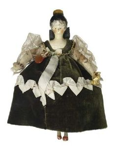 """Princess Victoria's doll """"Gertrude, Lady Arnold"""" a fictitious character. This doll is illustrated in the book """"Queen Victoria's Dolls"""" in this costume. c. 1832"""