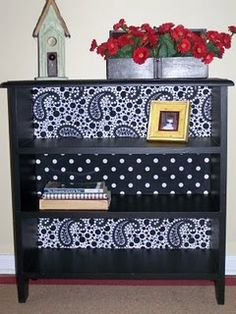 We are refinishing two yardsale find bookshelves and I <3 the idea of putting wallpaper in the back to give it some spice!