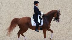 Hiroshi Hoketsu of Japan riding Whisper competes in the Dressage Grand Prix