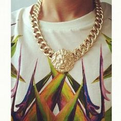 big gold necklace.
