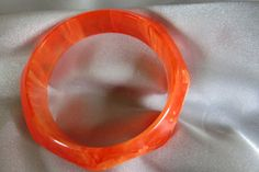Vinta bakelite bangle bracelet chunky facet marbled orange transparent and opaque