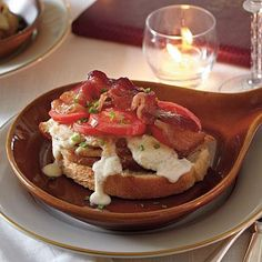 Kentucky Hot Browns | In need of a little comfort? Tuck into the classic knife-and-fork sandwich smothered in Mornay sauce for a decadent Southern dish. | SouthernLiving.com