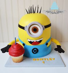 the movie Despicable Me. White cake and jumbo cupcake with vanilla buttercream covered in fondant.