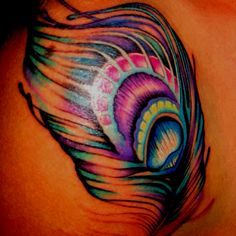 #peacock feather tattoo on the armpit