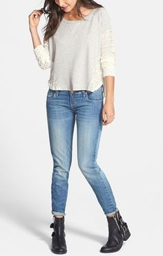 Casual cute with sweatshirt, jeans and boots.