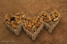 Spread corks in a wooden basket and glue. Great for a little wall art above your wine rack.